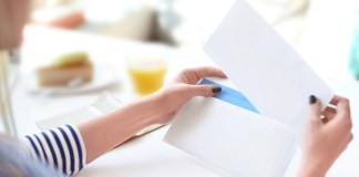 Woman Filling Envelope