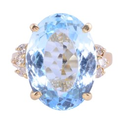 Oval Blue Topaz Yellow Gold Ring