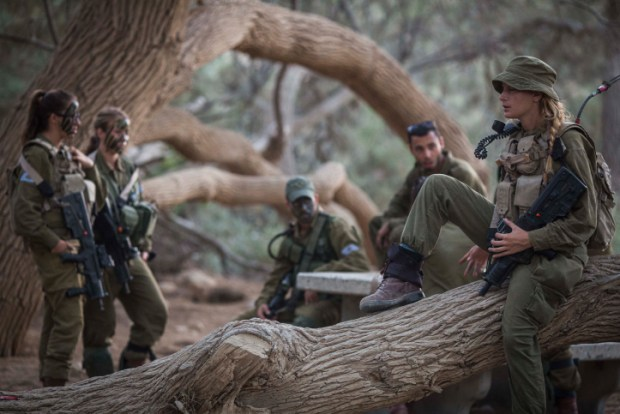 "Soldiers of the Caracal Battalion seen resting before beginning a 16 Kilometer journey overnight to complete their training course, in Azoz village, southern Israel, near the border with Egypt, September 3, 2014. Formed in 2004, the Caracal Battalion is an infantry combat battalion of the Israel Defense Forces, composed of both male and female soldiers, which is stationed along the Egyptian border. Most of the Caracal soldiers are female. Photo by Hadas Parush/Flash90 *** Local Caption *** ???? ???? ???? ??? ????? ????? ???? ????? ?????? ?????? ???? ????? ??? ????? ??""? ????? ??????"