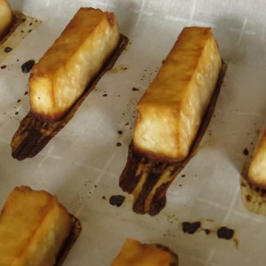 Baked tofu with soy sauce on parchment paper