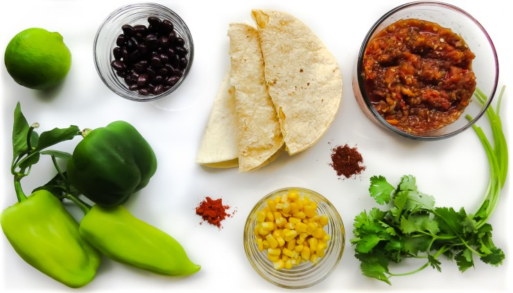 Ingredients for taco night with black beans, corn and bell peppers