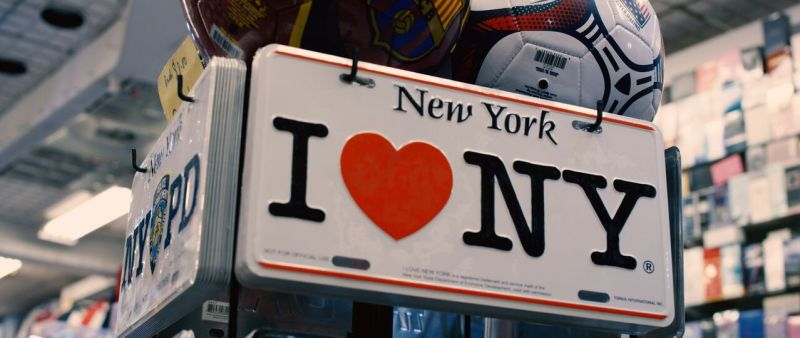 Novelty license plate with the I Heart NY symbol photographed in Times Square.