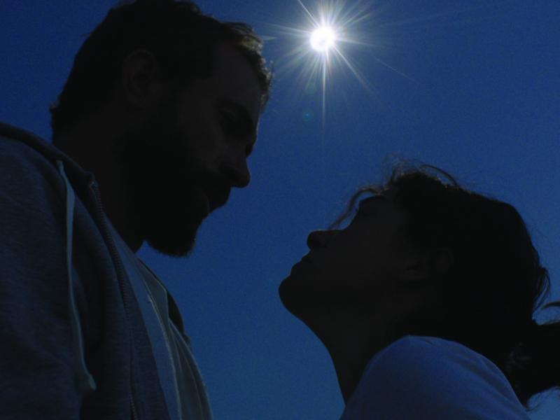 Tom Cullen and Tatiana Maslany in the path of totality. From SOULS OF TOTALITY.