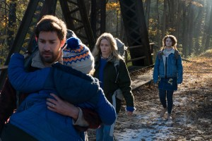 Left to right: Noah Jupe plays Marcus Abbott, John Krasinski plays Lee Abbott, Emily Blunt plays Evelyn Abbott and Millicent Simmonds plays Regan Abbott in A QUIET PLACE.