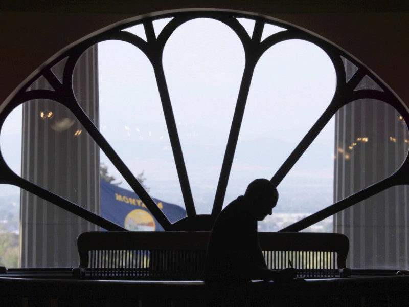 John S. Adams silhouetted in the Montana Capitol building, from DARK MONEY, a PBS Distribution release.
