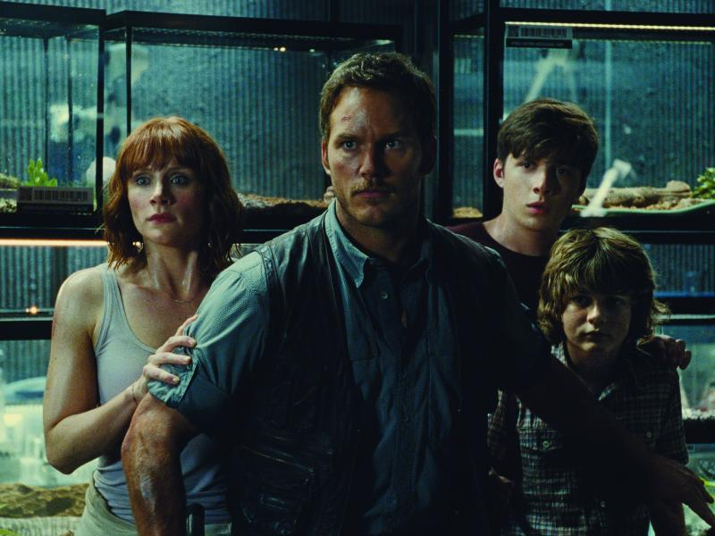 (L to R) Claire (BRYCE DALLAS HOWARD), Owen (CHRIS PRATT), Zach (NICK ROBINSON) and Gray (TY SIMPKINS) watch in terror in Jurassic World.