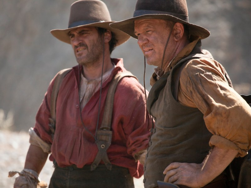 "Joaquin Phoenix (left) stars as ""Charlie Sisters"" and John C. Reilly (right) stars as ""Eli Sisters"" in Jacques Audiard's THE SISTERS BROTHERS, an Annapurna Pictures release."