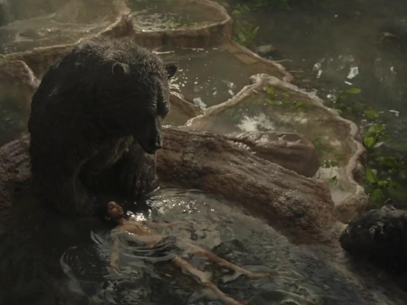 "Baloo and Rohan Chand as ""Mowgli"" in the Netflix film ""Mowgli: Legend of the Jungle."""