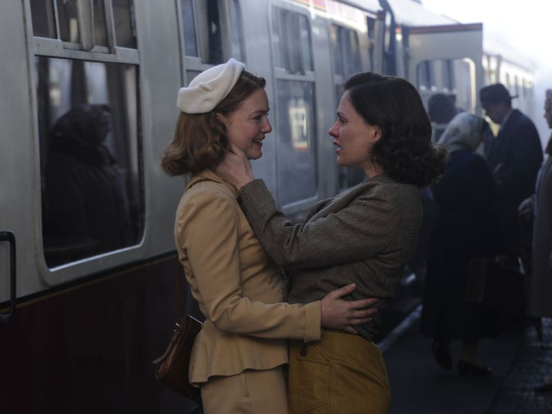 Holliday Grainger and Anna Paquin in a scene from TELL IT TO THE BEES.