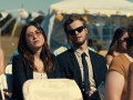 Maya Erskine as Alice and Jack Quaid as Ben in the romantic comedy Plus One, an RLJE Films release.