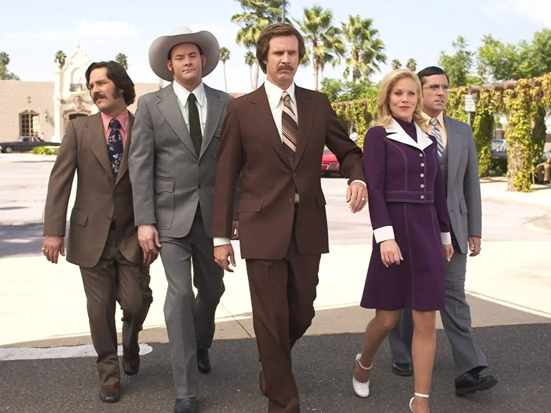 "Brian Fantana (Paul Rudd), Champion ""Champ"" Kind (David Koechner), Ron Burgundy (Will Ferrell), Veronica Corningstone (Christina Applegate), and Brick Tamland in Anchorman: The Legend of Ron Burgundy."
