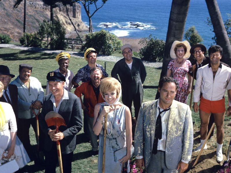 "From far left going clockwise: Dorothy Provine, Spencer Tracy, Buddy Hackett, Eddie ""Rodchester"" Anderson, Peter Falk, Mickey Rooney, Jonathan Winters, Ethel Merman, Phil Silvers, Dick Shawn, Terry Thomas, Sid Caesar, Edie Adams and Milton Berle in It's A Mad, Mad, Mad, Mad World"