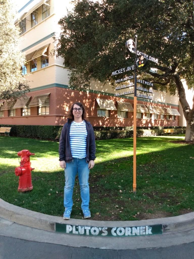 Danielle Solzman poses along Pluto's Corner at Mickey Avenue and Dopey Lane.