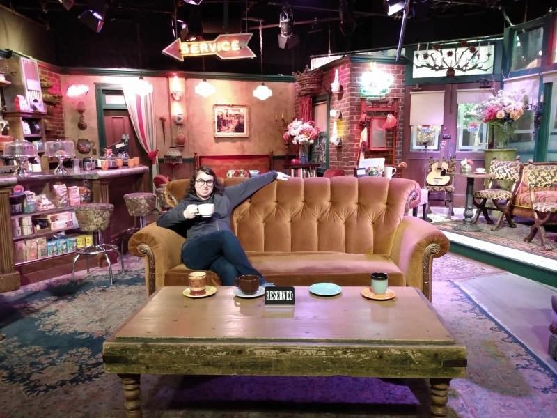 Danielle Solzman sits in the Central Perk set.