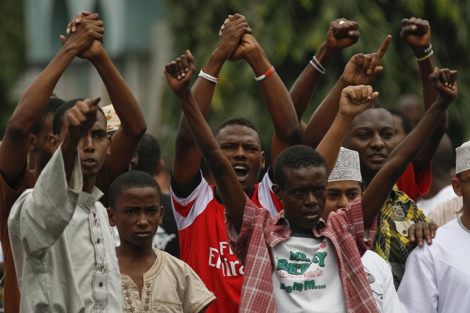 Young Muslims protest in 2012 after the killing of a cleric accused of supporting Al-Shabaab. EPA/Dai Kurokawa