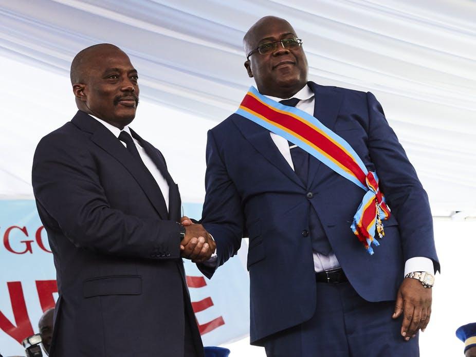 Former DRC President Joseph Kabila congratulates President Felix Tshisekedi at his inauguration. EPA-EFE/Hugh Kinsella Cunningham