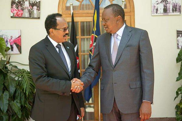 Kenya's President Uhuru Kenyatta (right) with his Somalia counterpart Mohamed Abdullahi Mohamed at State House, Nairobi. Behind Kenya-Somalia dispute, analysts say, are economic and political interests of others.