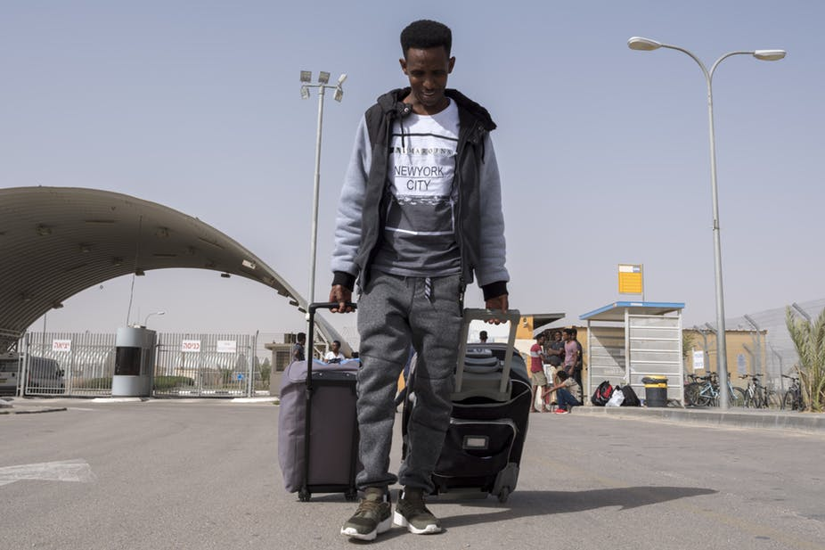 An Eritrean migrant leaves a detention facility near Nitzana in the Negev Desert in Israel, near border with Egypt. EPA-EFE/Jim Hollander