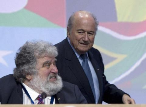 "FIFA President Sepp Blatter (R) walks behind the general-secretary of the Caribbean, North and Central American (CONCACAF) Chuck Blazer, the US official whose claims led to the suspension of Asian football chief Mohamed bin Hammam and Jack Warner of Trinidad andTobago, on June 1, 2011 at the start of the 61st FIFA congress at the Zurich Hallenstadion in Oerlikon near Zurich. Blatter vowed on June to steer FIFA through ""troubled waters"" ahead of his expected re-election as head of football's corruption-tainted governing body. AFP PHOTO / SEBASTIAN DERUNGS"