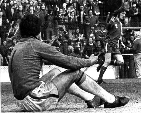 Cardiff City's Robin Friday gives a two finger salute to Luton goalkeeper Milija Aleksic after scoring his second goal at Ninian Park on Saturday. 16th April 1977.