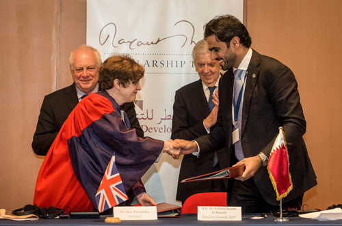 Dr Prochaska and Mr Al-Kuwari shake hands after signing the Memorandum of Understanding