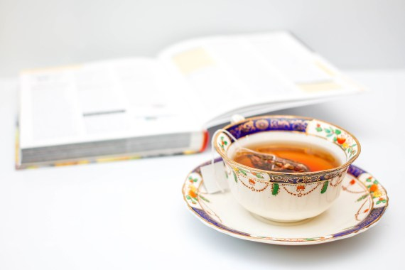 Tea cup and book