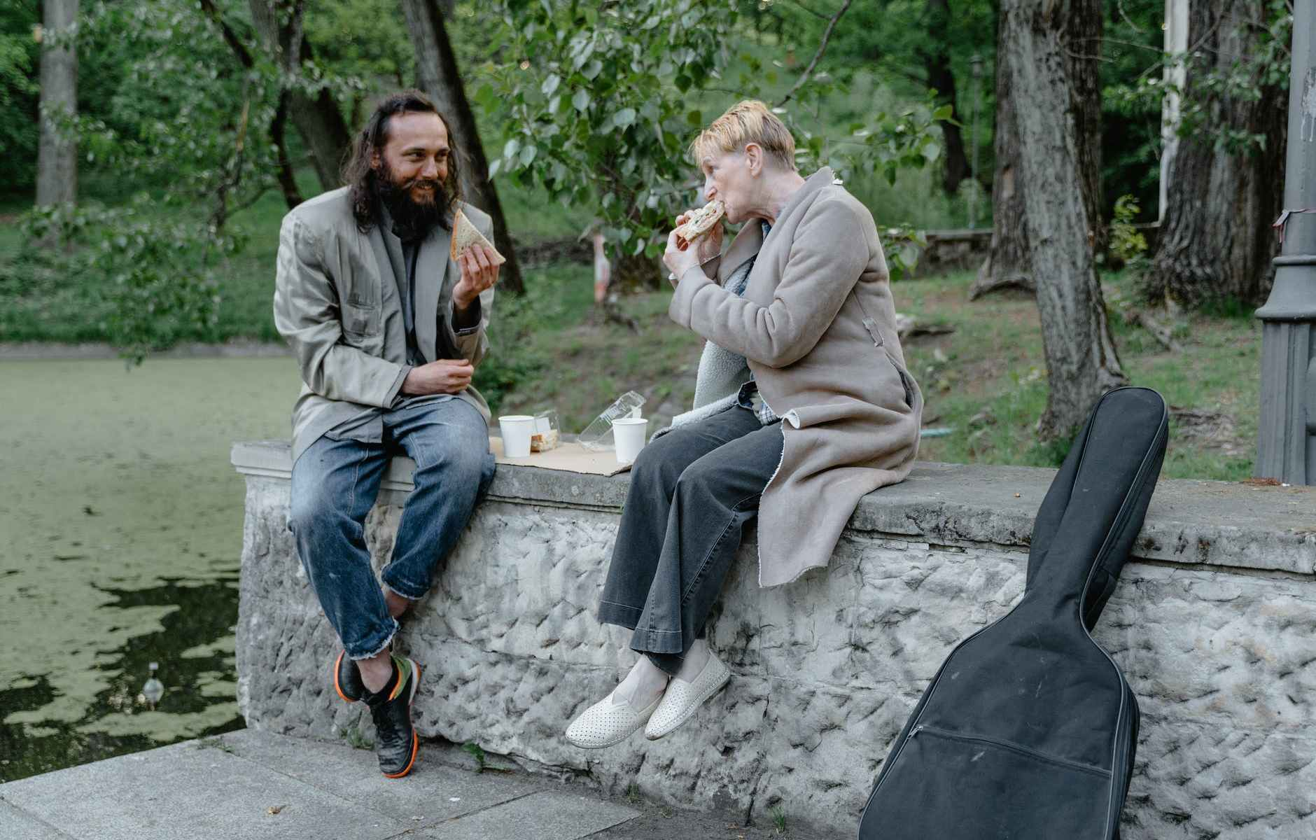 man and woman eating at a park