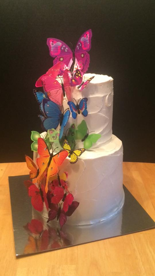 Large Tiered Cake with Paper Rainbow Butterfly Accents