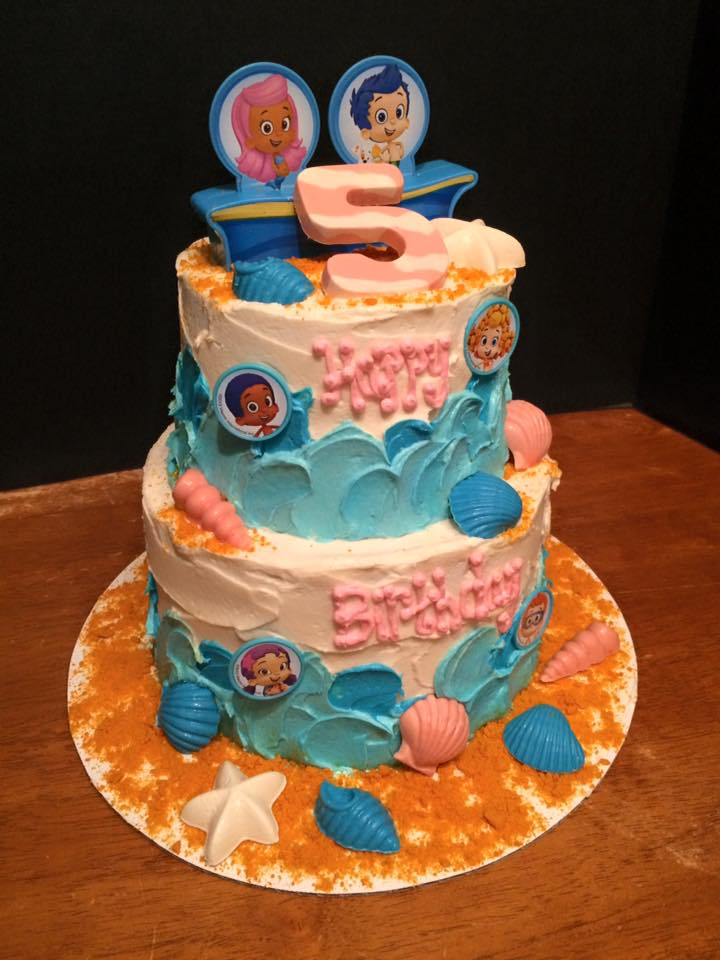 Bubble Guppies Themed Birthday Cake with Buttercream Finish, Candy Melt Shells, and Plastic Decor