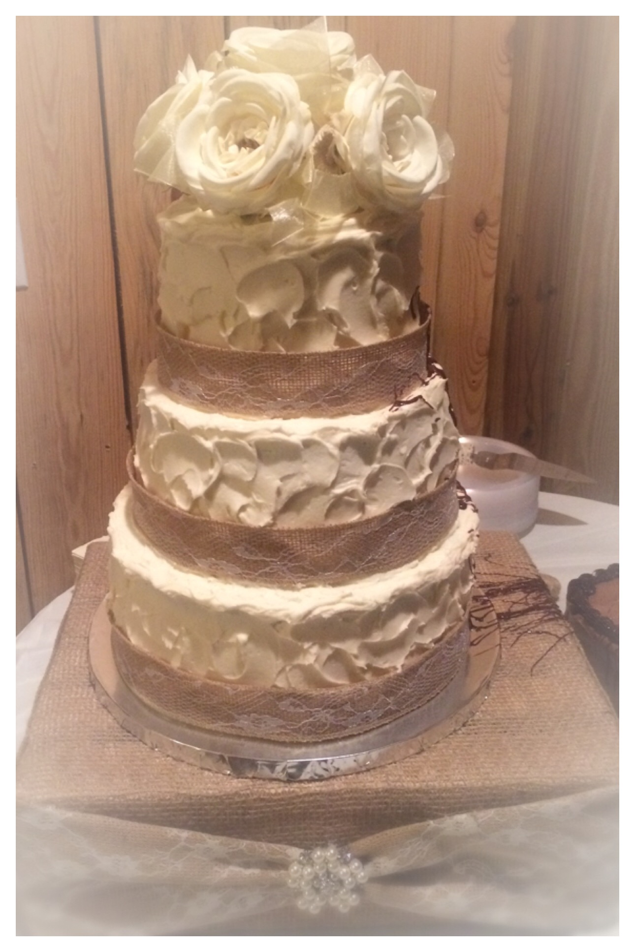 rustic wedding cake with swirl textured buttercream finish, silk flower topper, burlap and lace ribbon