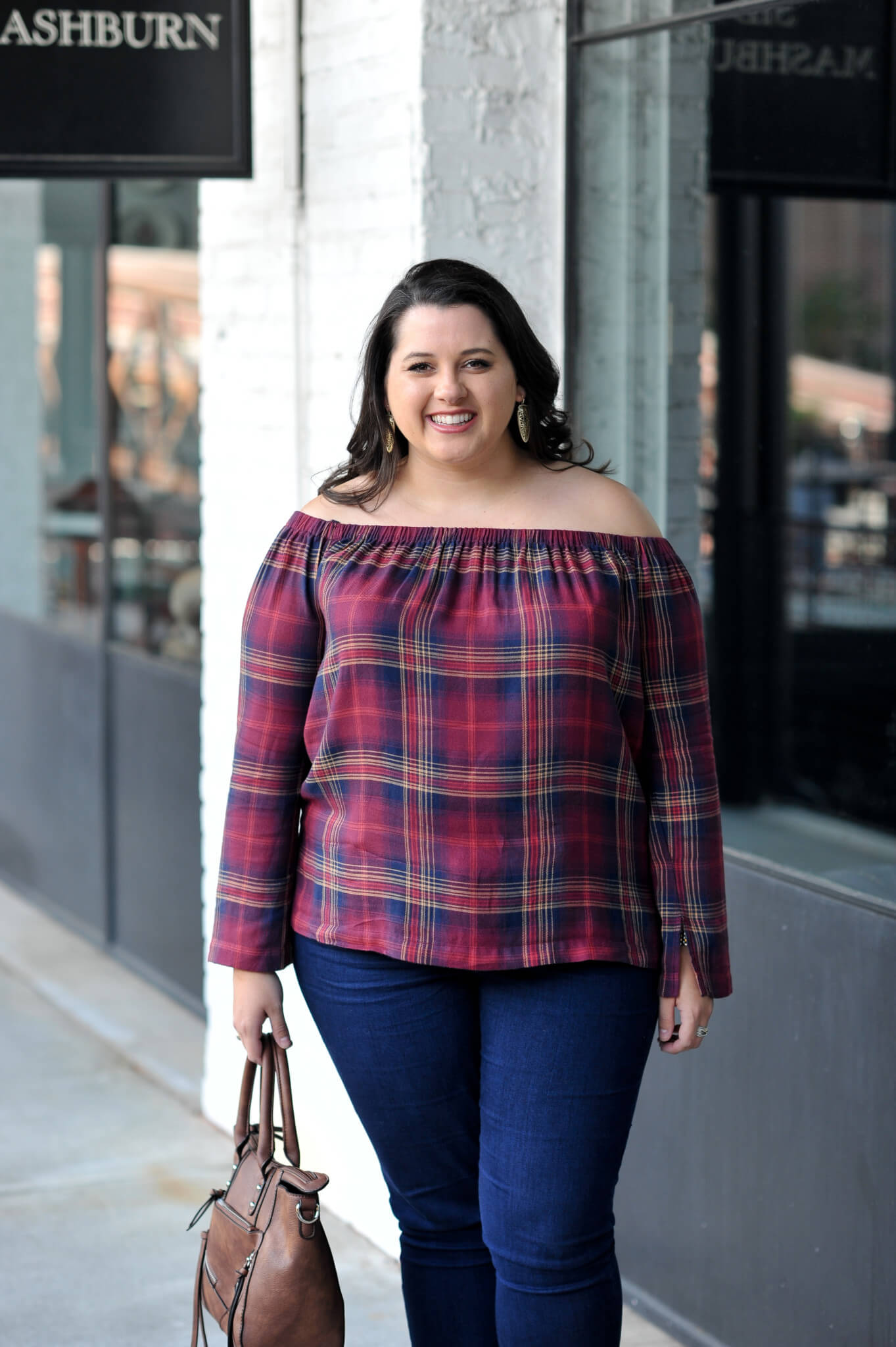 Emily Bastedo from the curvy style blog, Something Gold, Something Blue shares a great fall transition outfit with this adorable off the shoulder plaid top from Anthropolgie, a pair of skinny jeans, Toms wedges and a gorgeous bag from Pinkstix.
