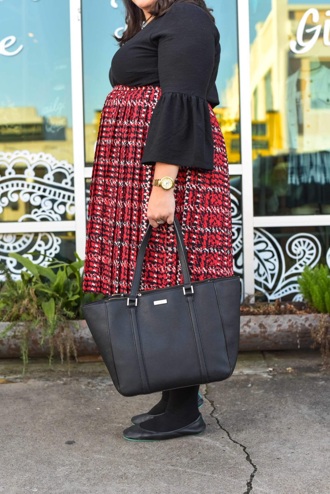 Dressing for all of the holiday season functions can be difficult epecially when you work long hours. Emily Bastedo from the curvy style blog Something Gold, Something Blue, is sharing her solution by styling a red plaid skirt and unique black sweater from Eloquii paired with gorgeous and comfortable Just My Size tights and Tieks.
