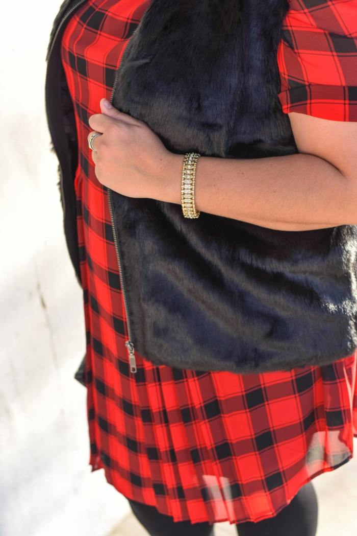 The holidays can be stressful, but having a casual holiday party look planned out and ready to go is one way to help simplify your to do list. This red buffalo plaid shirt dress and black faux fur vest from Foxcroft make the perfect combination with some glamorous jewelry. - @EmilySGSB - Curvy Style Blogger from Something Gold, Something Blue