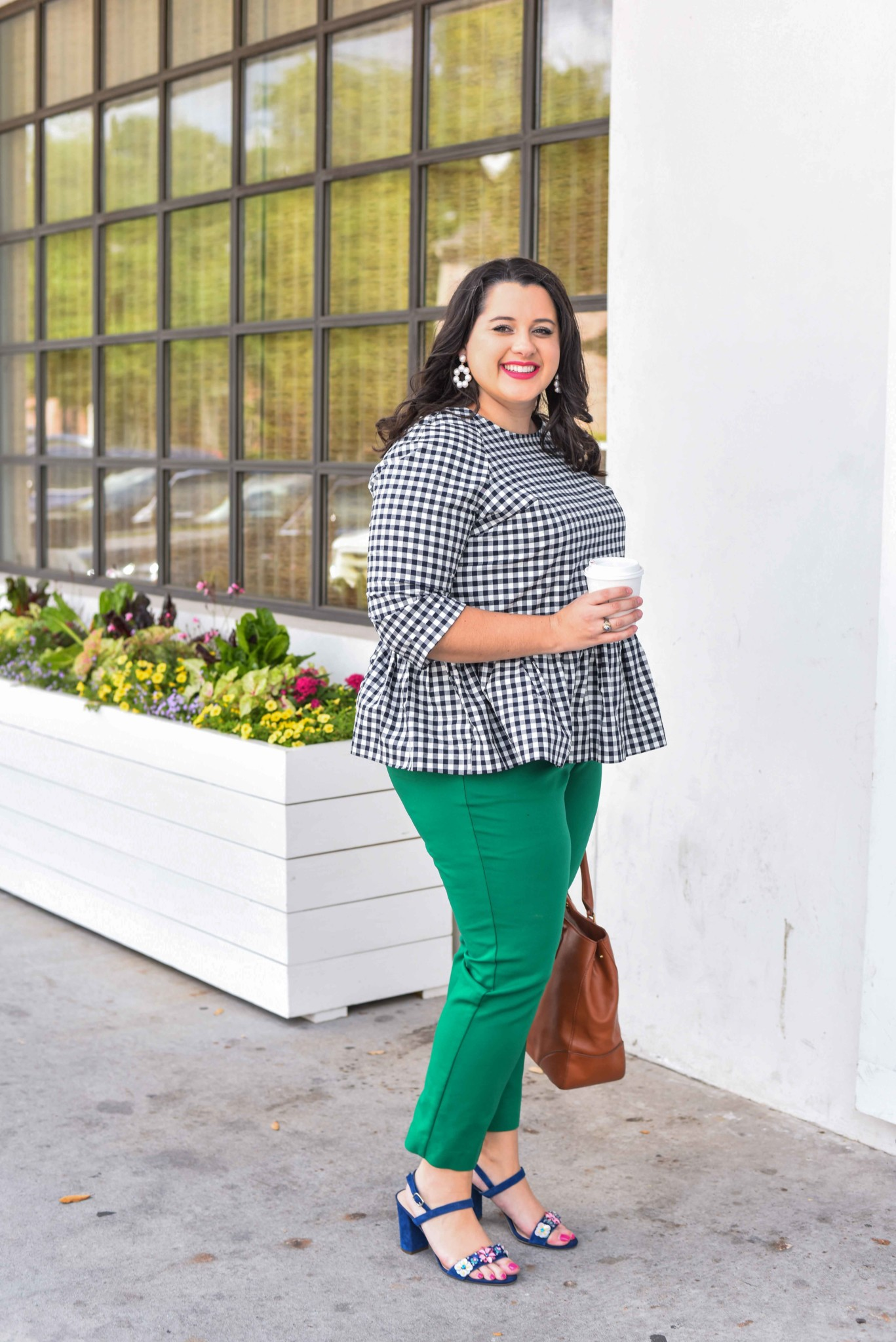 Traveling can be stressful, especially when your flight is delayed or even worse, cancelled. In today's blog post, I'm sharing a few travel delay tips that will help you make the best of the situation. I'm also talking about wearing a quintessential preppy item, a gingham peplum top. Emily Bastedo from the curvy style blog, Something Gold, Something Blue, is sharing how she is styling this gorgeous spring top perfect for both work and happy hour. Plus size, curvy, fashion, style, travel tips.- Travel Delays by popular Houston travel blogger Something Blue, Something Gold