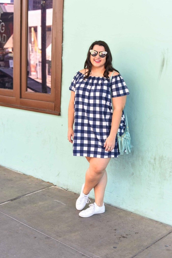 A gingham off the shoulder dress is a perfect way to kick off the summer. This preppy off the shoulder dress is perfect for anyone who wants to look chic while being comfortable. Plus size style blogger, Emily Bastedo from Something Gold, Something Blue shares how she would style this blue gingham off the shoulder dress for a weekend casual look.