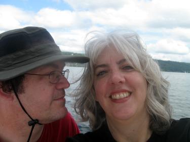 Pamela & Michael smile while sailing on Cayuga Lake.