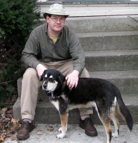 Shadow and Mike post on the front steps.