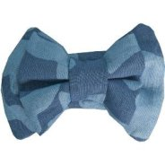 Dog's bow tie slips onto the collar.