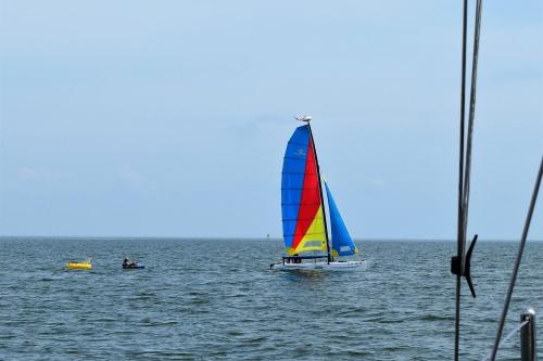 Sailboat off New Point Comfort Bight.