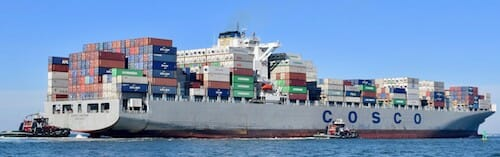 Container ship and tugs near Norfolk, Virginia.
