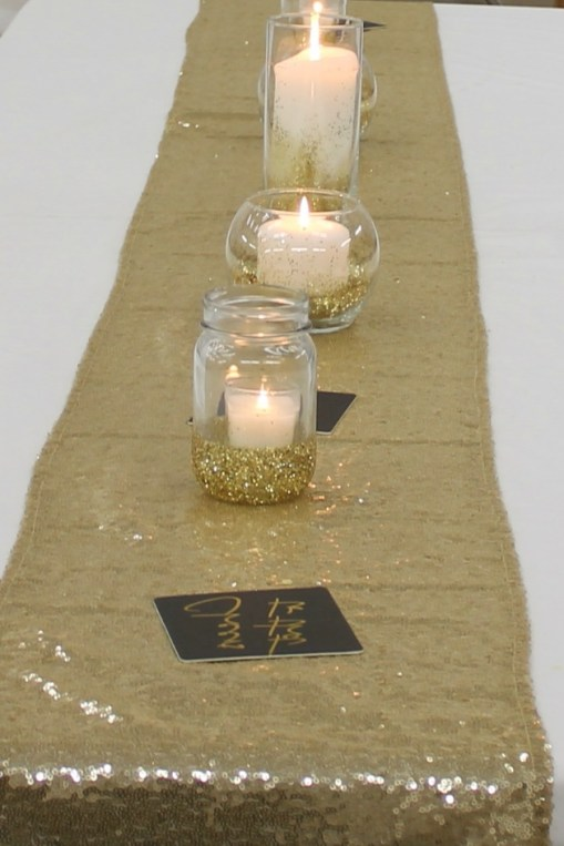 black-gold-cream-party-decorations-glitter-table-candles