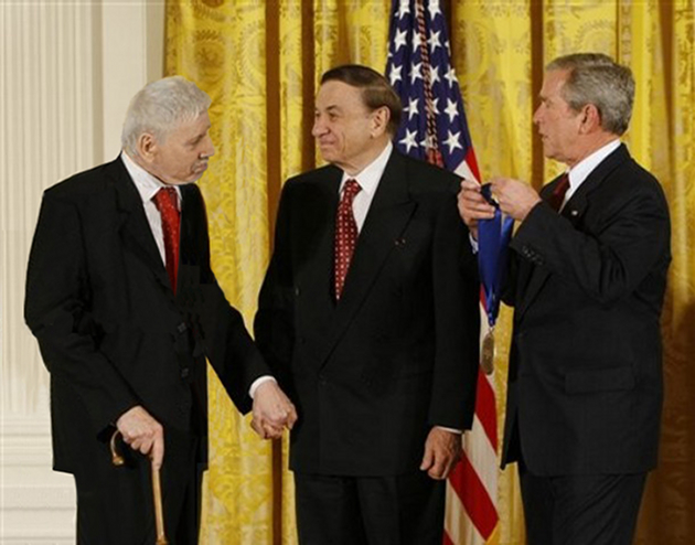 The Sherman Brothers receive the National Medal of Arts from US President George W Bush, 2008. Pic: AP Photo/Gerald Herbert