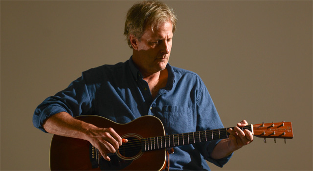 Jeff Daniels playing guitar