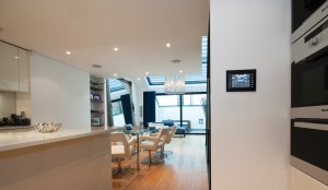 Control your home with Crestron controllers. Mount your controllers with Luxeport and iPort products (Lifestyle Image)