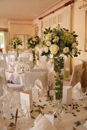 White and green tall table arrangements