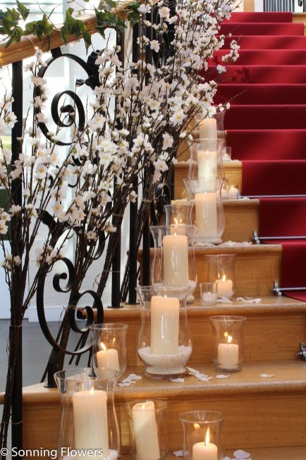 Candles and blossom at Botleys Mansion