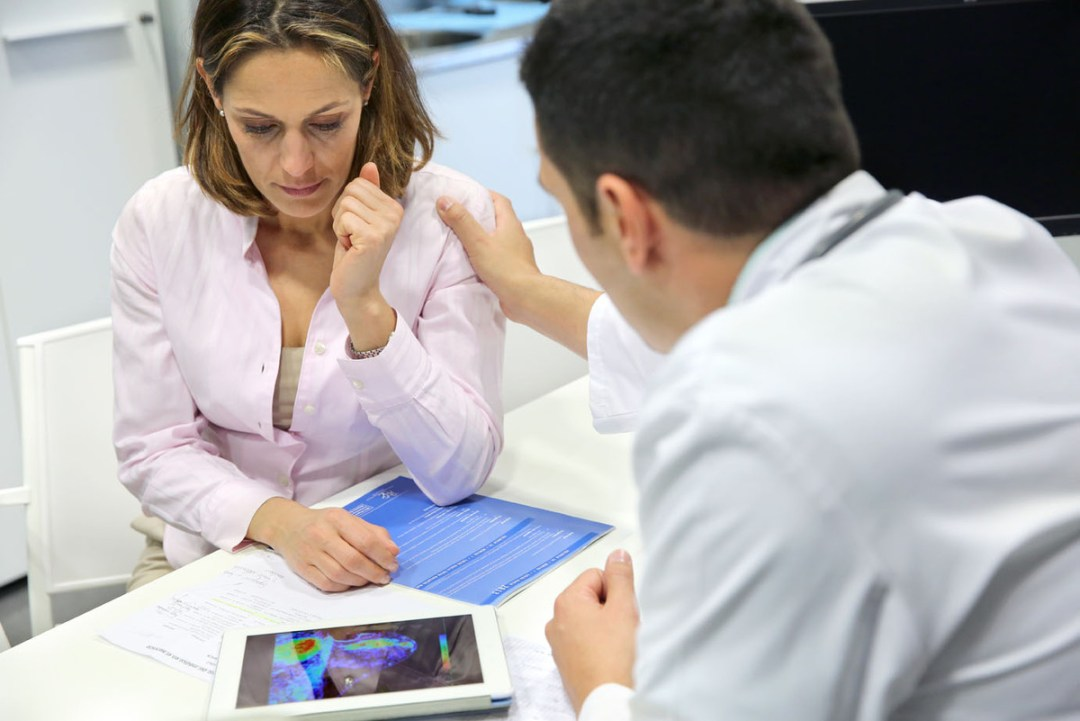 Doctor attending patient in medical office, explaining Mammography Test result, Breast Scintigraphy, Onkologikoa Hospital, Oncology Institute, Case Center for prevention, diagnosis and treatment of cancer, Donostia, San Sebastian, Gipuzkoa, Basque Country, Spain