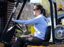 girl driving a lift truck