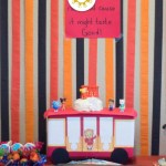 Food for a Daniel Tiger birthday party on a table with red, orange, and black streamers behind (with title overlay)