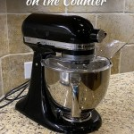 Kitchenaid Artisan standmixer on a granite counter (with simple title overlay)